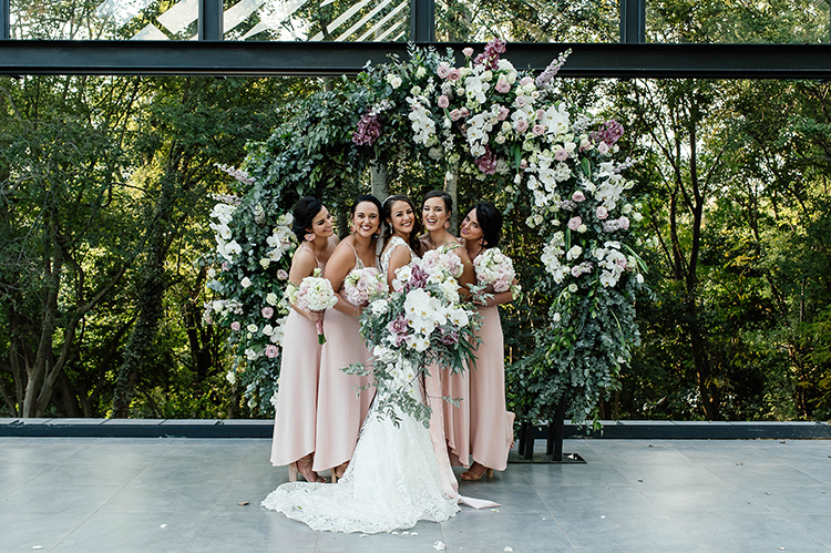 Beautiful bride smiling with her bridesmaids.