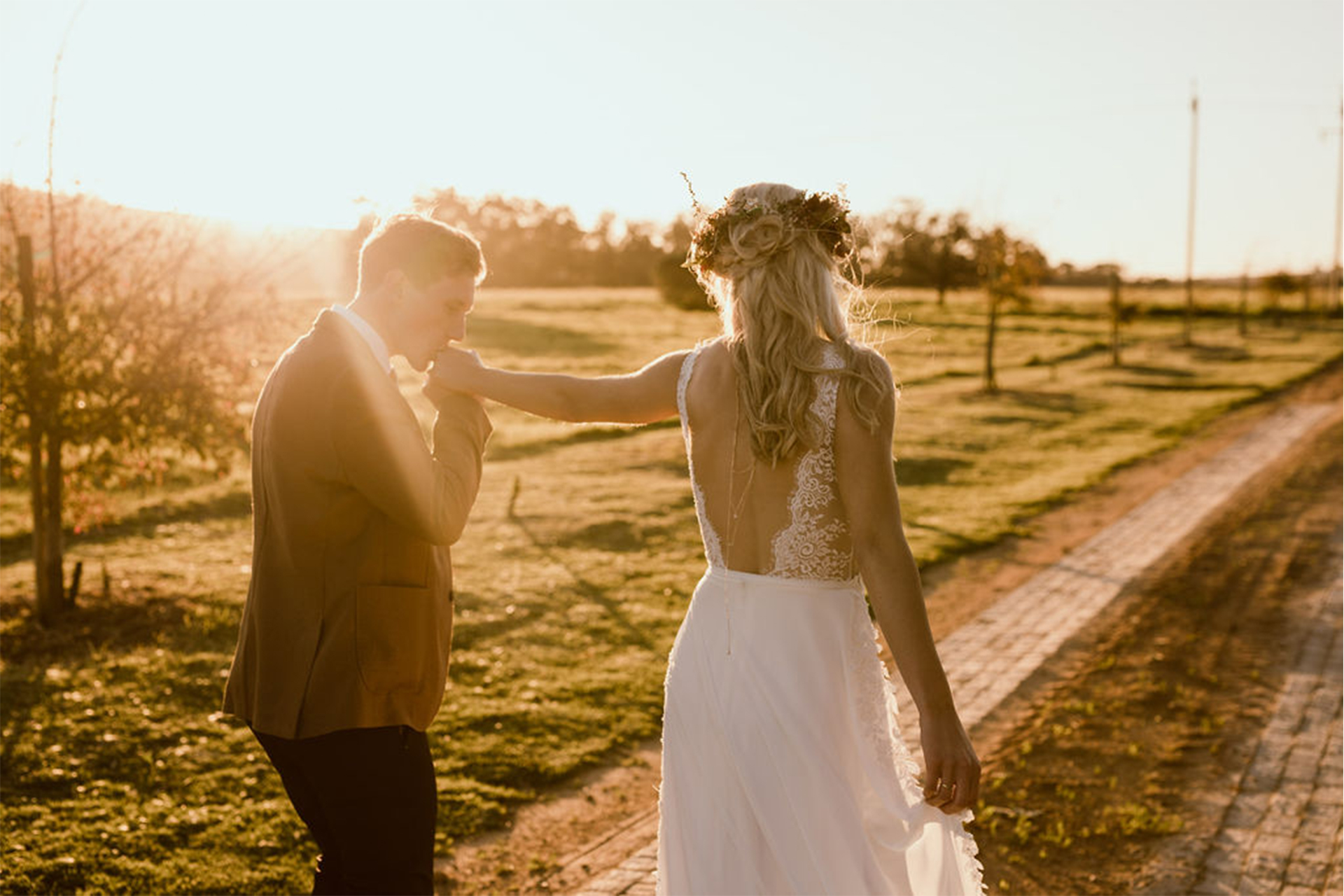 Husband and wife walking along during golden hour