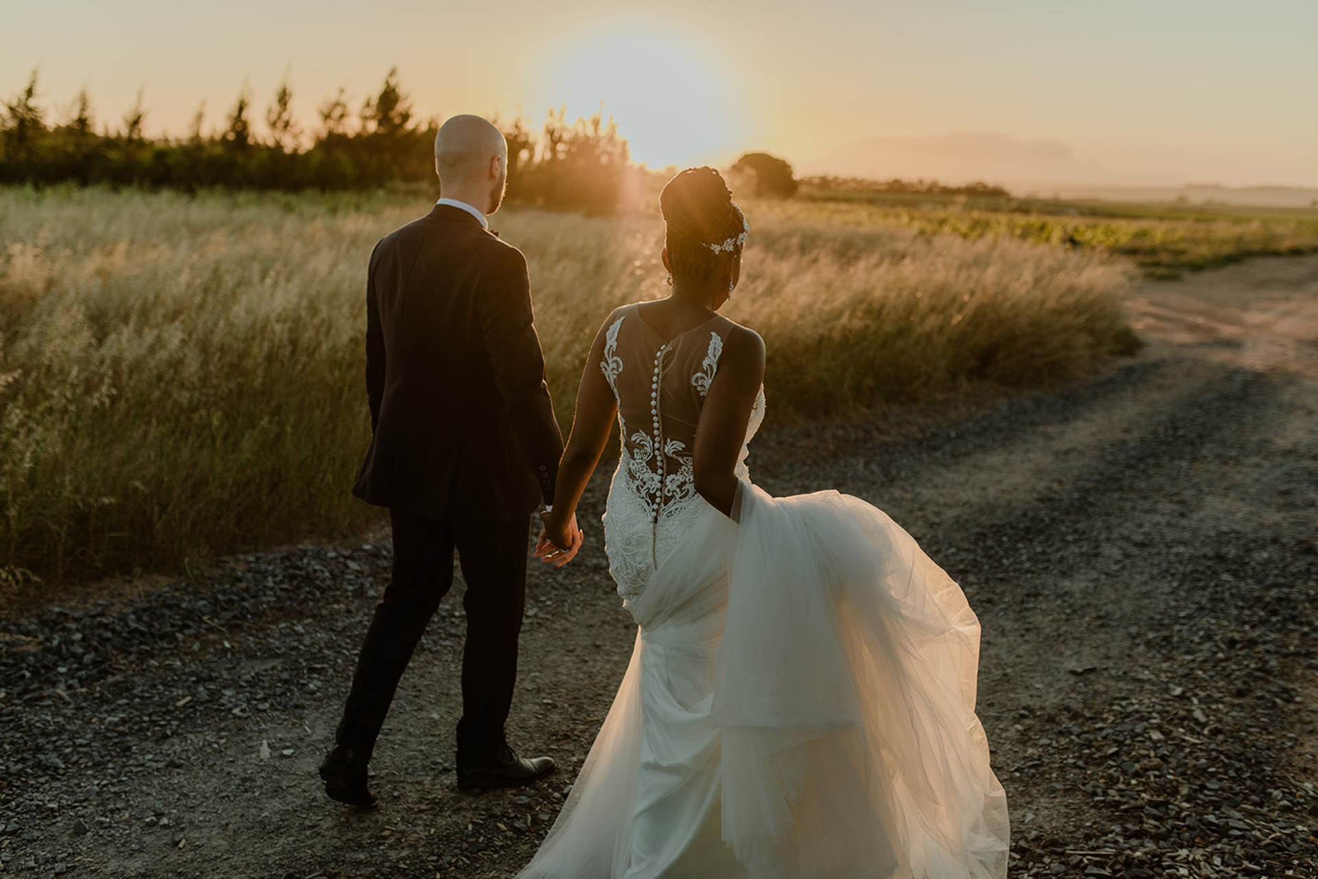 Husband and wife walking off into the sunset