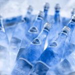 Close up shot of chilled water bottles in a ice bucket